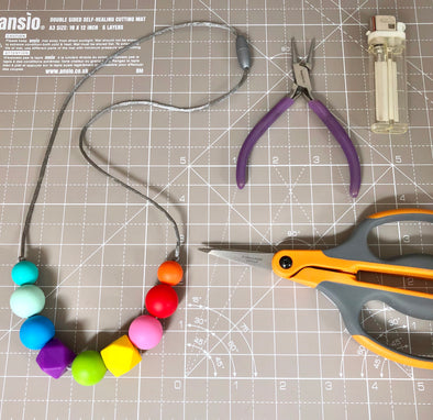 Timelapse Video of the Creation of a Rainbow Teething Necklace
