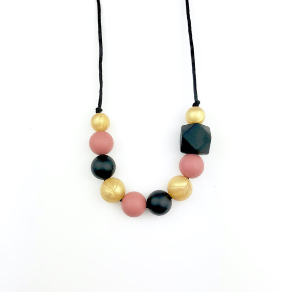 Black, gold and rust teething necklace