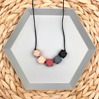 Baby Proof Teething Necklace in black, grey, peach, oatmeal and rust