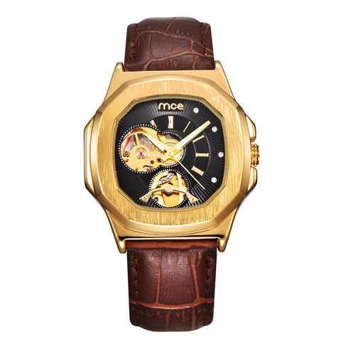 MCE rectangular mechanical watch with a golden case and black face held on a brown leather strap