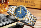 Tevise Mechanical Automatic watch with a stainless steel bracelet, golden bezel and a blue face