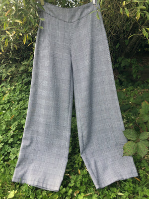 Grey check palazzo pants made with reclaimed textiles.