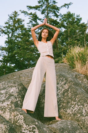 Model wearing palazzo pants made with reclaimed textiles.