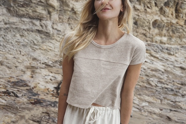 Model wearing Limited edition tees are made from reclaimed textiles. Sourced natural sustainable fibres
