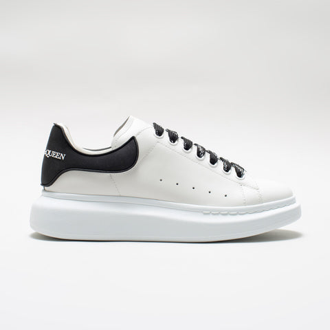 ALEXANDER MCQUEEN RAISED SOLE LOW TOP SNEAKER RUBBER TAB WHITE/BLACK