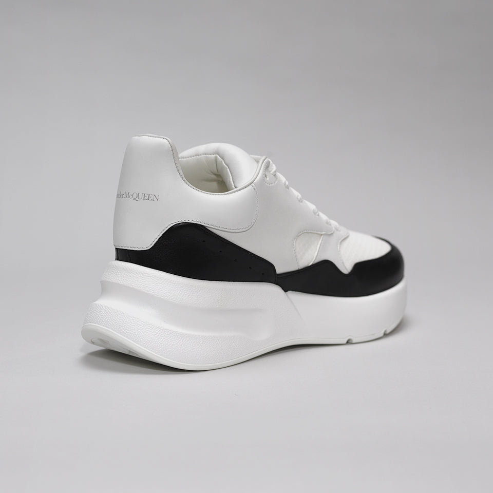 ALEXANDER MCQUEEN OVERSIZED RUNNER SNEAKERS WHITE/BLACK