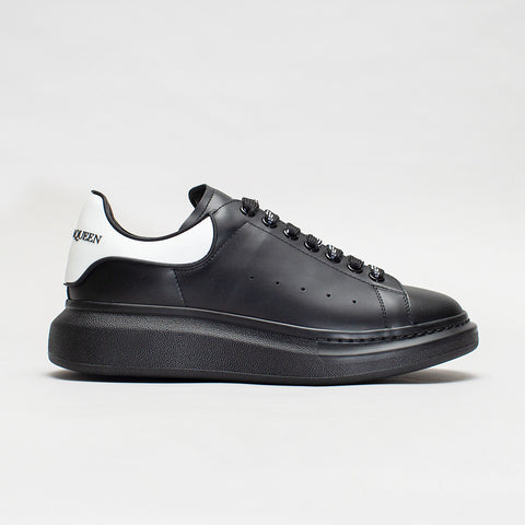 ALEXANDER MCQUEEN RAISED SOLE LOW TOP SNEAKER RUBBER TAB BLACK