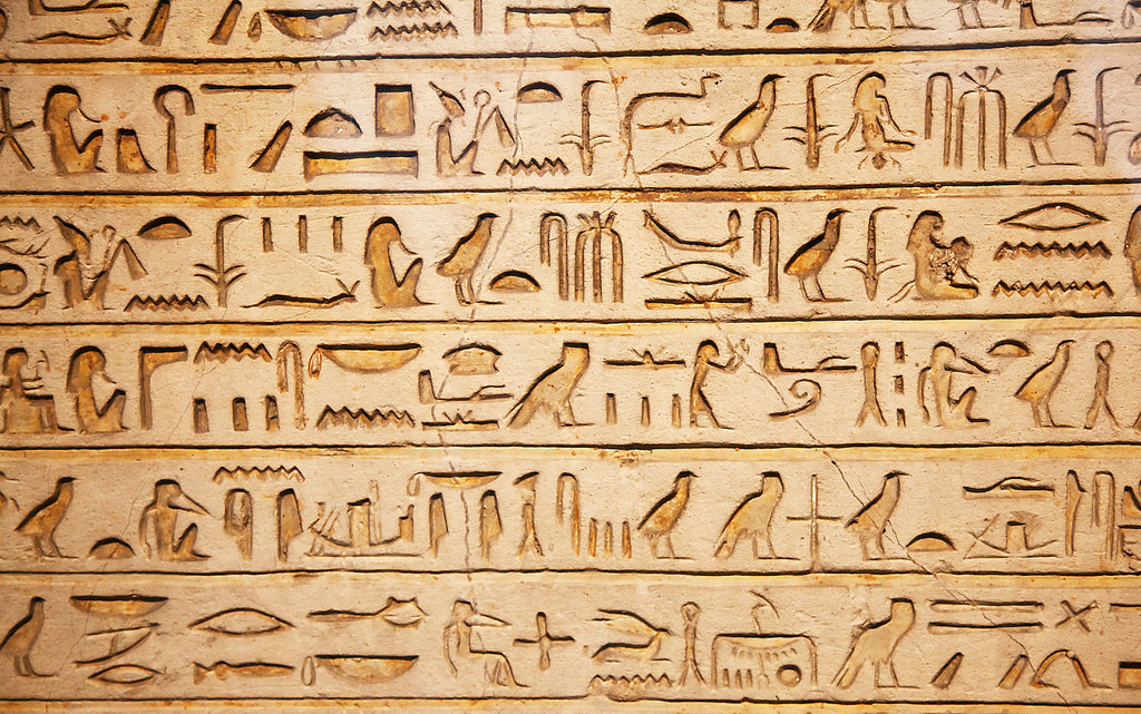Ancient Egyptian hieroglyphics carved into a wall