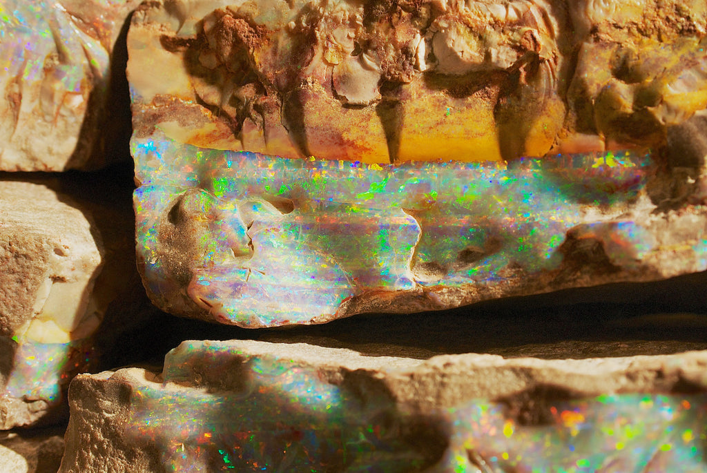 Boulder opal inlaid in the surrounding rock