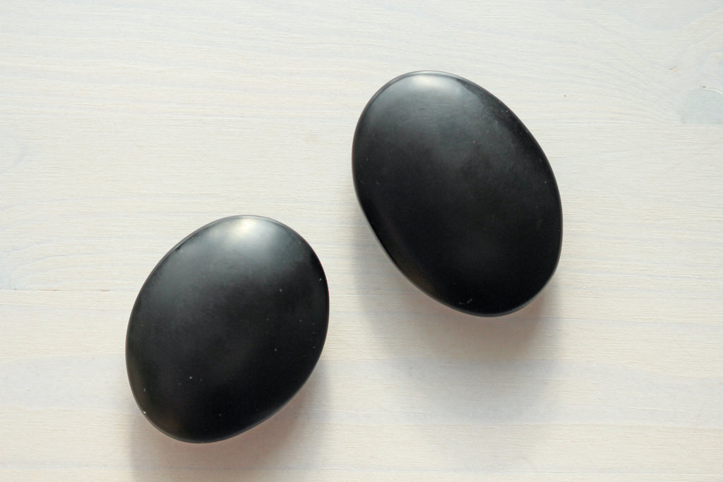 Two polished shungite cabochons