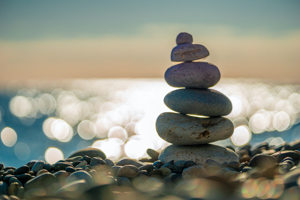 Balancing stones on the beach