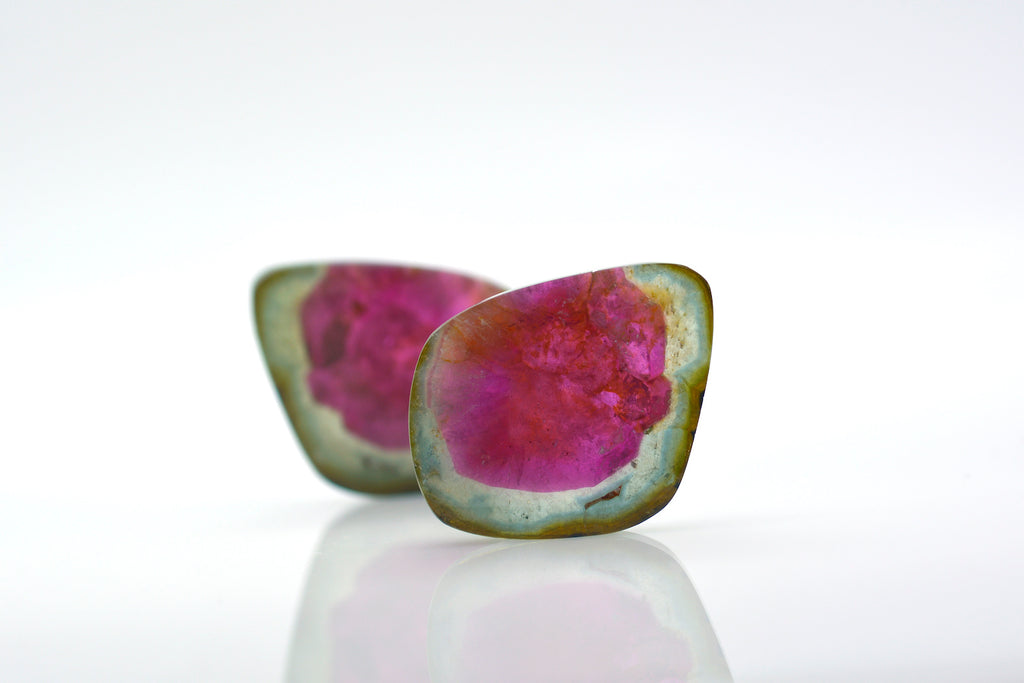 a watermelon tourmaline stone split in half