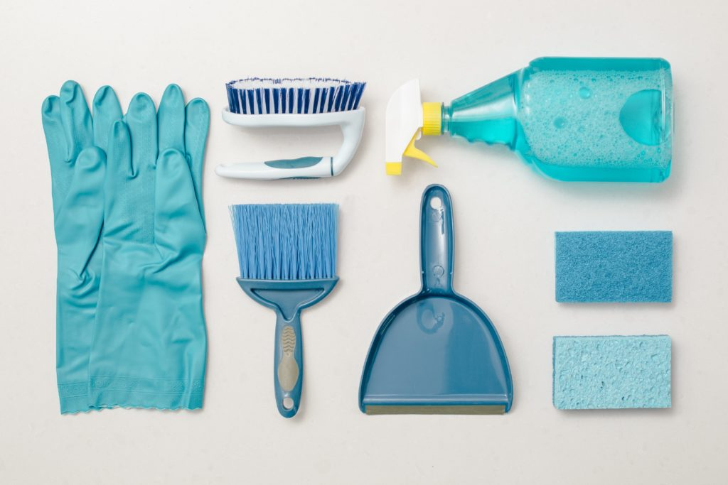 Flat-lay of blue cleaning supplies and equipment.