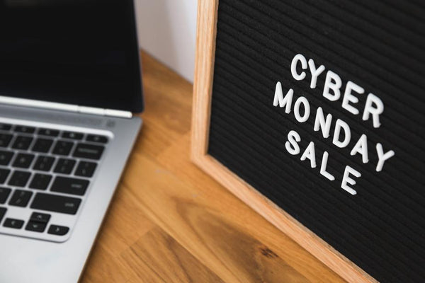 Cyber Monday sale sign on desk