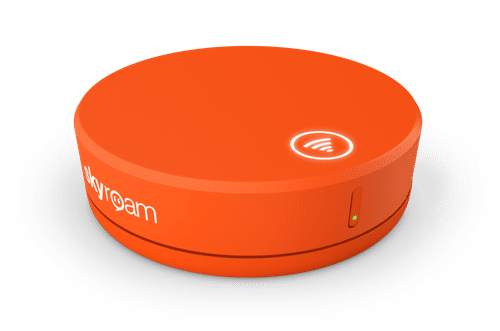 Skyroam orange puck for internet connection.