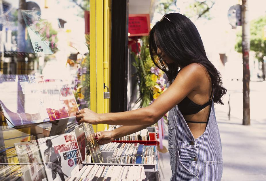 Woman shopping for records at a store.