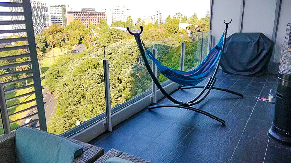 Hammock and stand on apartment balcony