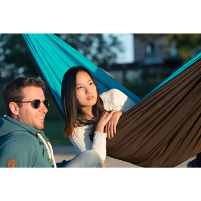 Turquoise travel hammock with polyester filling