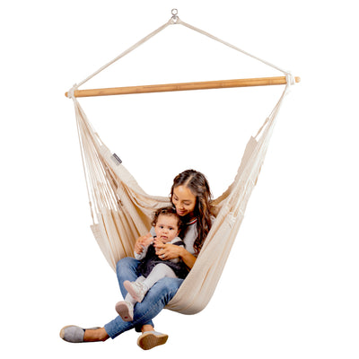 Mother and child enjoying relaxing hammock chair