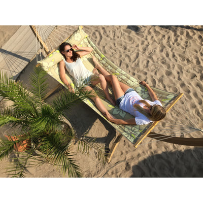 Two woman sharing hammock on wooden stand