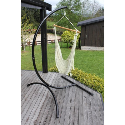 Freestanding hammock chair stand with white cotton Mexican hammock chair on deck