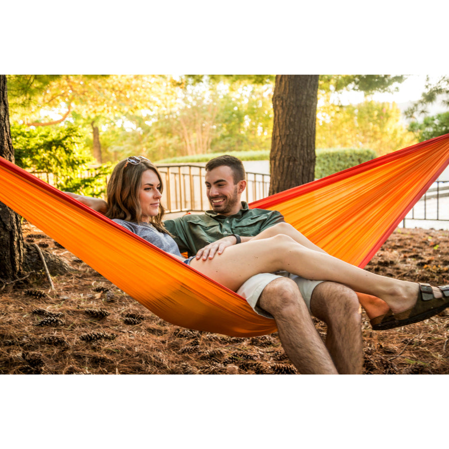 Bright orange travel hammock for two