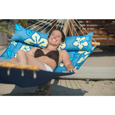 Happy woman relaxing on large hammock