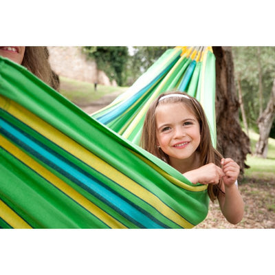 child in green hammock