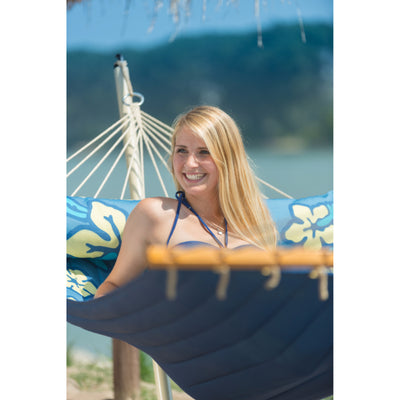 Blond woman on blue hammock