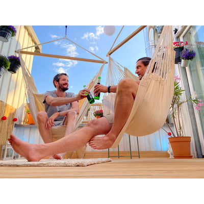 Enjoying hammock time and drinks with friends