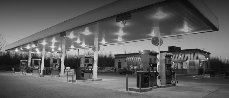 Background image of a gas station