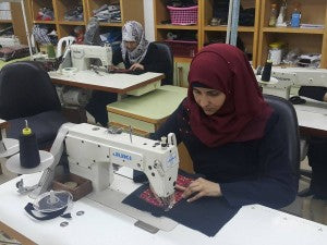 Siham & Ola at their sewing machines