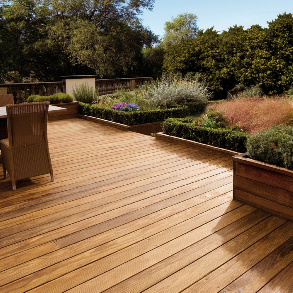 Outdoors decking, covered with Firmtread Anti Slip Deck Coating. Garden in background.