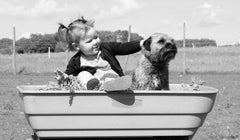 Child with Border Terrier