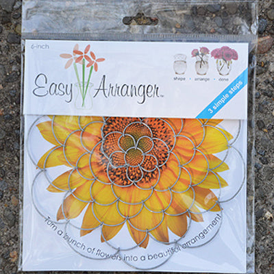 A package of 3 different sizes of handcrafted wire doilies for arranging flowers in a vase