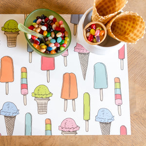 Ice cream social paper placemat is shown here with a bowl of jelly beans and crisp waffle ice cream cones for a fun childrens party.
