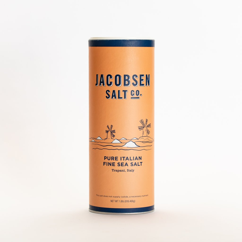 Picture of the Jacobsen Salt companies Pure Italian Fine Sea Salt harvested from Trapani Italy. it is a 1.8 oz canister
