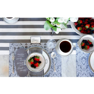 A photograph of the tapestry placemat in breakfast table setting