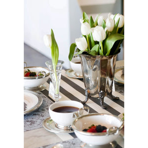 A photograph showing the Tapestry Placemat in a more formal table sitting with the use of silver rimmed dinnerware