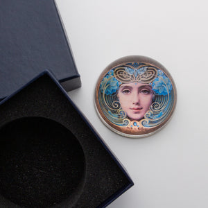 Crystal Domed Paperweight decoupaged with a Art Nouveau Woman's face shown with the padded box for gift giving