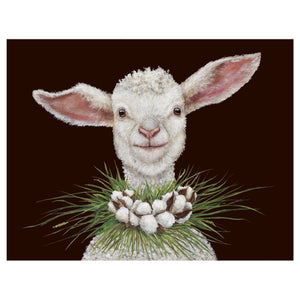 A sweet baby lamb with a grass and cotton ball wreath around her neck