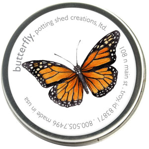 Showing the product butterfly seed kit in a small round tin. On the label is a beautiful butterfly.