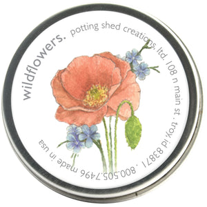 A picture of the wildflower seed kit. It comes in a small metal tin with a lovely label with some wildflowers on it.