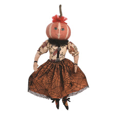 This is Penelope Pumpkin, She is dressed in a orange skirt with a black spider web overlay. She has a flowered blouse and a black ruffed collar with a orange ruffle on her head.