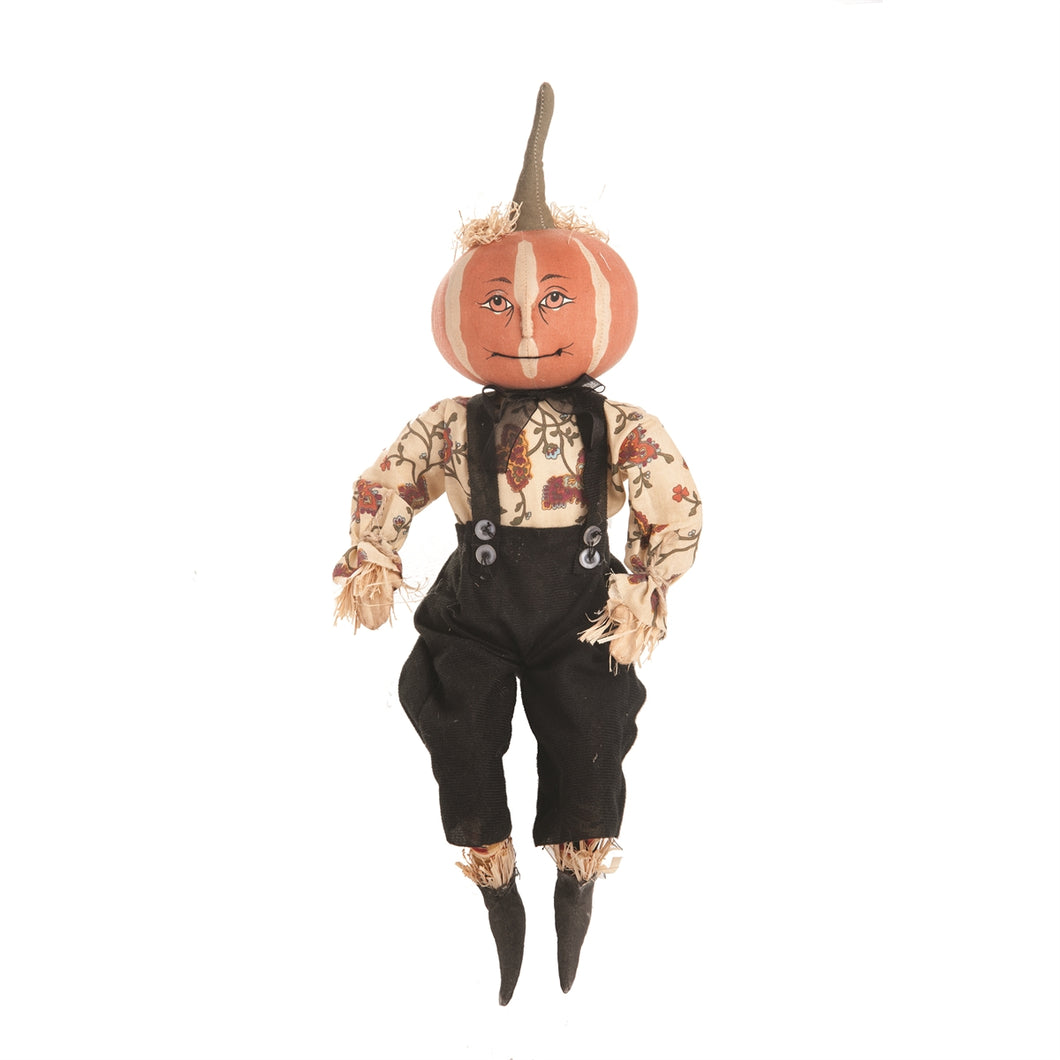 Parnell  The pumpkin head doll Dressed in black overall with a floral shirt. pumpkin head and straw stuffing from his shirt and pants