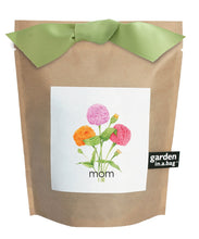 A picture of the garden in a bag package. It is brown paper with a white label with flowers on the label with the words MOM .