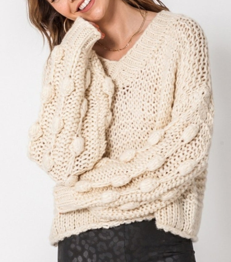 Pom pom sleeve sweater