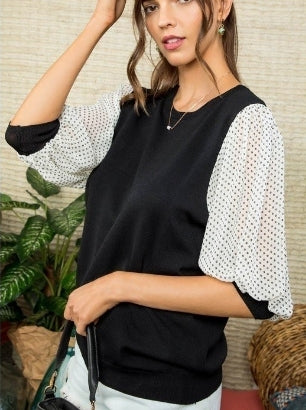 Black knit top with contrast sleeves