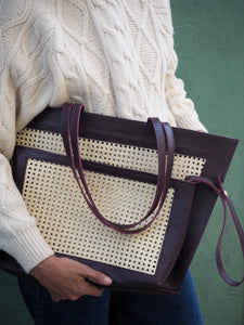 Burgundy  leather tote bag and clutch bag in handwoven rattan weave