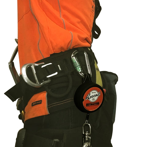 Retractable tool lanyard on harness